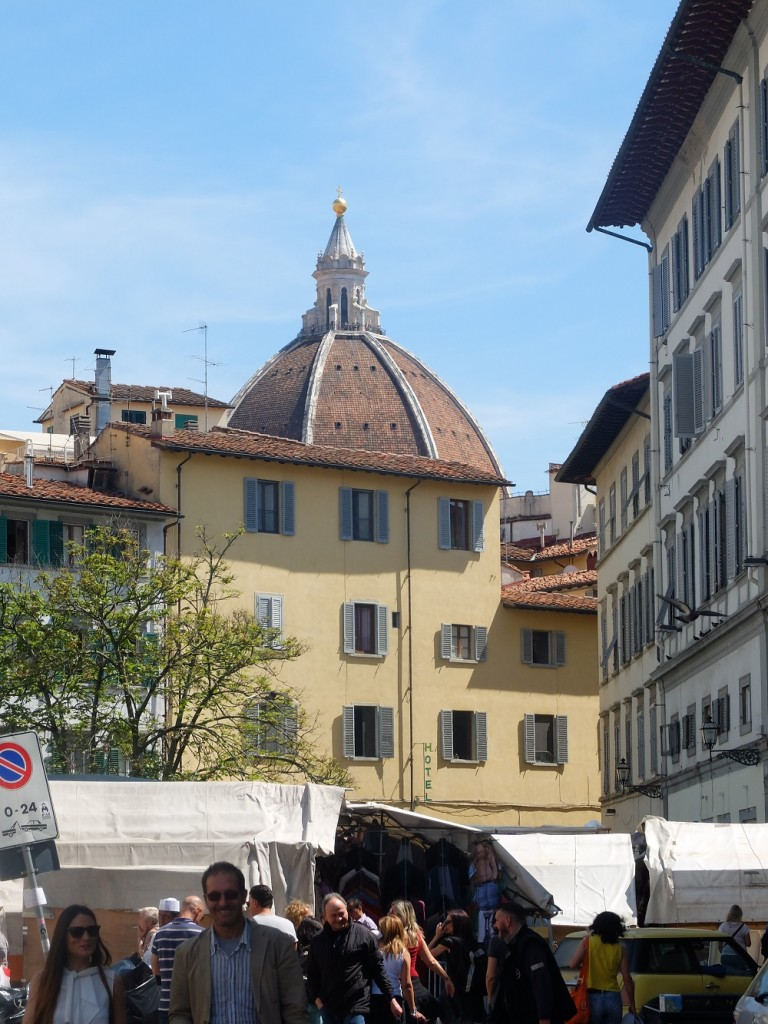 Duomo peeking among the stands in San Lorenzo (not where you will find made in Italy).