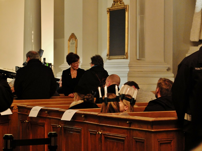 Little girls donning their own 'wreath of candles' in Helsinki's Cathedral this past December
