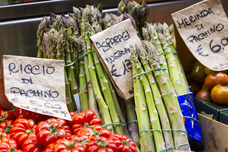 Green asparagus on mediterranean market stand Bologna Italy.