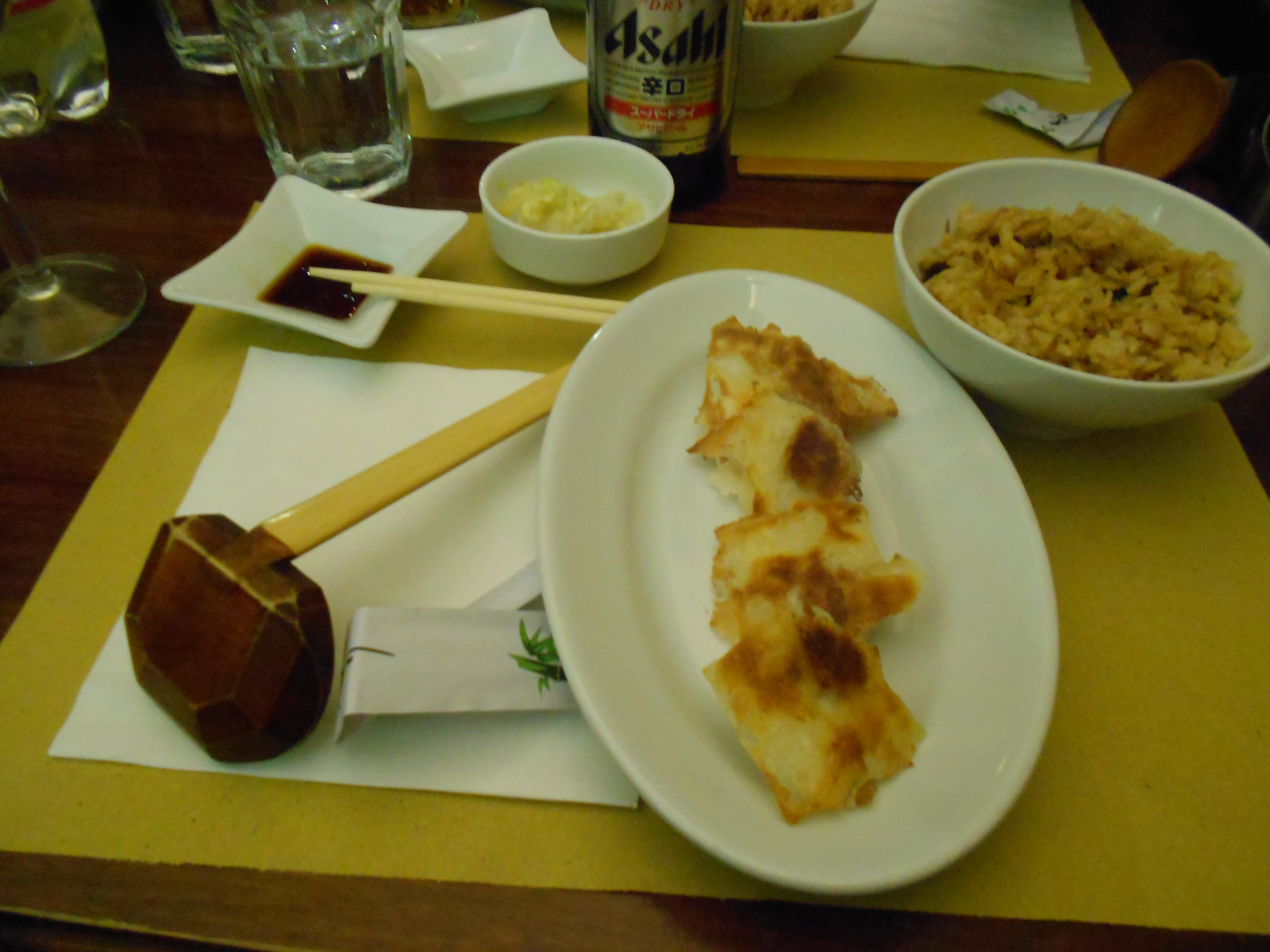 A delicious combination of food, gyoza, fried rice, and cabbage