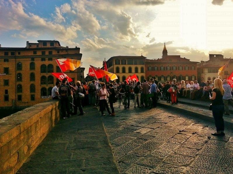 Scene on Ponte Santa Trinita in Florence, Italy   Girl in Florence blog