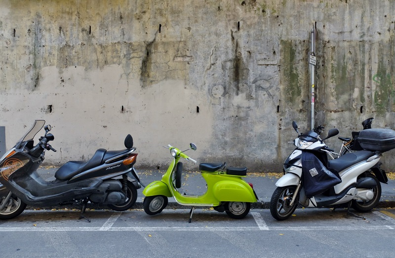 Pretty vintage yellow/green vespa on via romana, a nearby street that I adore